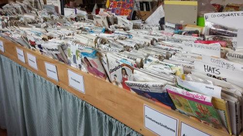 A table full of vintage patterns, all kept in order.  Amazing, when I think of how many people were rifling through them